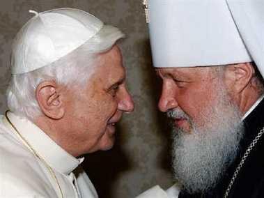 File photo of Pope Benedict XVI meeting Russia's Metropolitan Kirill (R) at the Vatican on May 18, 2006_