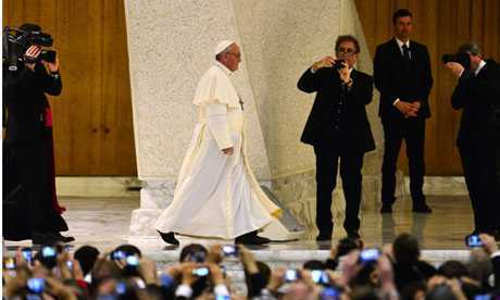 People take pictures of Pope Francis