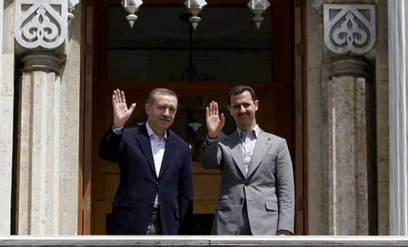 Turkey's Prime Minster Erdogan and Syria's President Bashar al-Assad greets members of the media in Istanbul