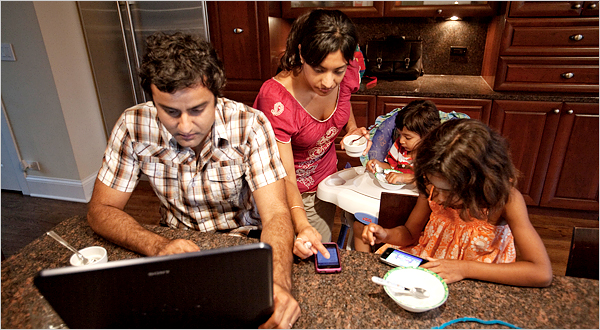 Thakkar's texting aroud their children