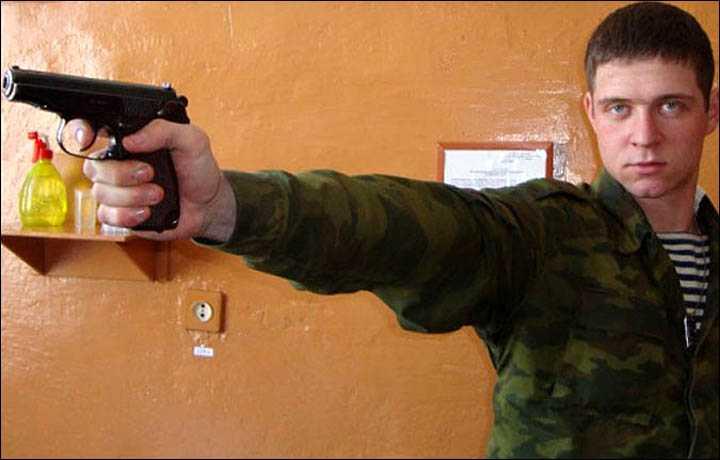 komarov with a gun
