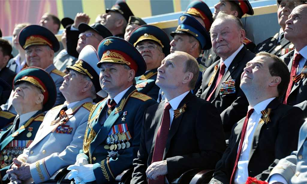 President Vladimir Putin and prime minister Dmitry Medvedev watch a Victory Day fly-past in Moscow