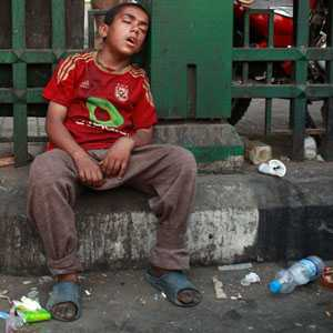 Boy sleeps during a sit-in protest against the military council at Tahrir Square in Cairo