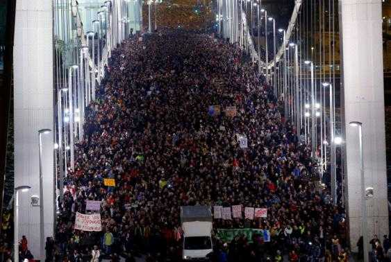 Ten of thousands of Hungarians march across the Elisabeth Bridge during a protest against new tax on Internet data transfers in centre of Budapest