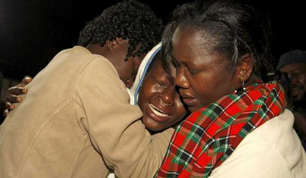 People react after meeting their relative who was rescued from the Garissa University attack at Nyayo stadium in Nairobi, following Thursday's seige by gunmen in their campus in Garissa