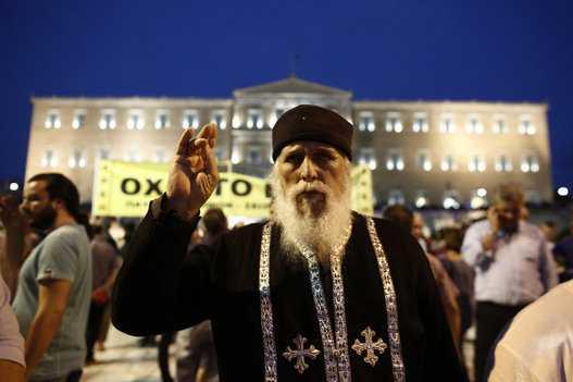 <i>Actualizat</i> – ARHIEPISCOPUL IERONIM al Greciei indeamna, implicit, pentru un vot DA la REFERENDUM. Relatari contradictorii din Muntele Athos: unii monahi il invoca pe SFANTUL PAISIE AGHIORITUL pentru un VOT DA, altii cer poporului grec sa VOTEZE NU