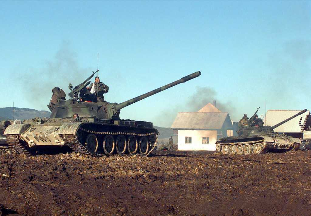 Two Croatian Defense Council (HVO) Army T-55 Main Battle Tanks pull into firing position during a three day exercise held at the Barbara Range in Glamoc, Bosnia and Herzegovina.  The HVO Army was granted the use of the range for first time in 18 months to train their troops on the proper use of the tank, its 100mm main gun and 12.7mm machine gun.