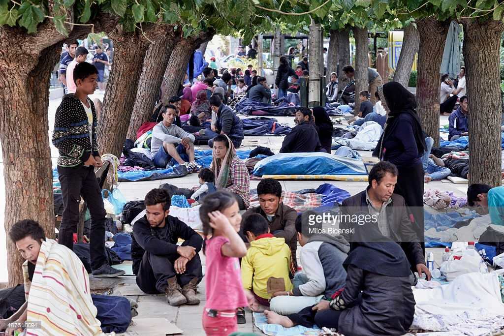 Several hundred migrants, mosly from Afghanistan rest outside on Victoria Square on September 10, 2015 in Athens