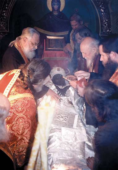 after-having-washed-the-relics-the-priests-are-vesting-the-saint-in-his-bishops-vestments.jpg