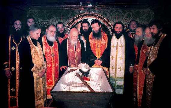 the-holy-relics-arrayed-in-new-hierarchal-vestments-and-placed-in-a-new-coffin-around-participants.jpg