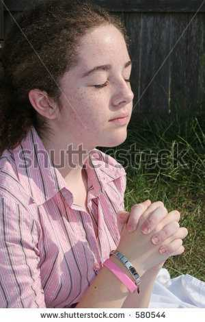 stock-photo-a-cute-teen-girl-praying-toward-heaven-580544