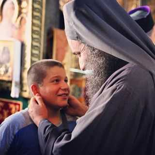 fr.Gregory with a kid in Vatopedi