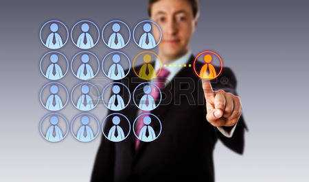 43538776-smiling-manager-is-touching-a-single-male-white-collar-worker-icon-outside-an-organized-group-of-mal